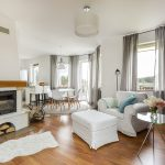 Cozy light flat interior with new furniture fireplace and wooden floor panels